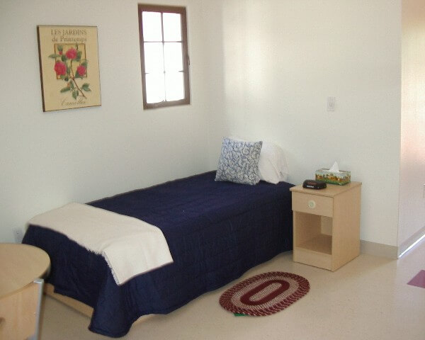 El Carrillo apartment bedroom with blue sheeted bed