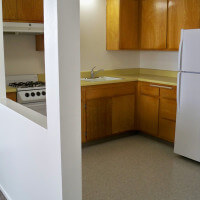 Inside a unit, showing the kitchen from the entryway