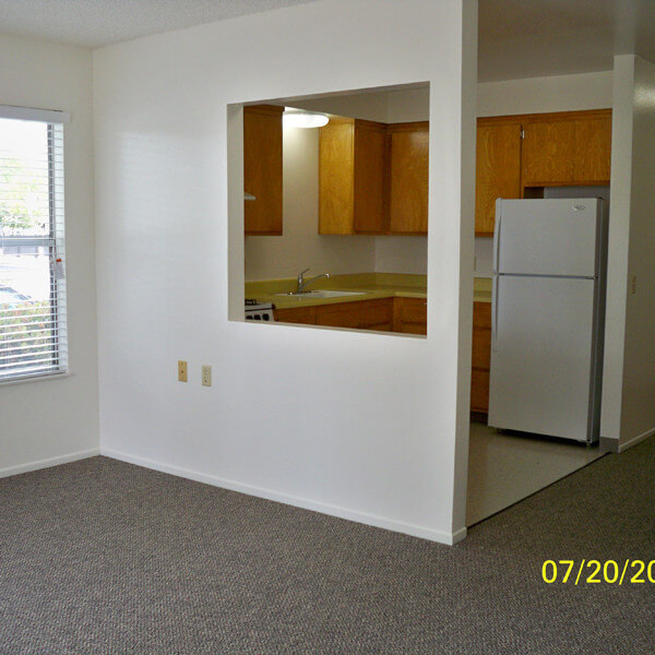 Inside a unit, showing the partial living room and kitchen