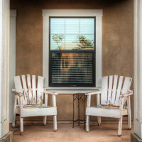 Outside view of two chairs under a window