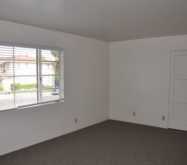 Inside a unit, view of the living room and window showing the street