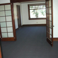Inside a unit, view of open doors leading to a room