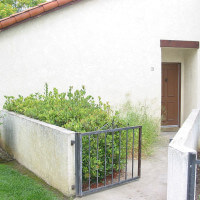 Outside view of a unit and the path leading to the door
