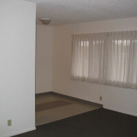 Inside a unit, view of the living room and partial hallway