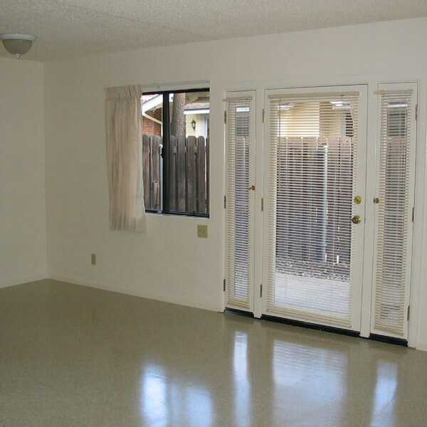 Insidie a unit, view of the living room with a door leading outside