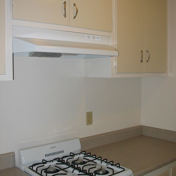 Inside a unit, view of the stove and cabinets