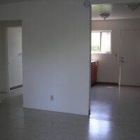 Inside a unit, view of the wall dividing the kitchen and living room