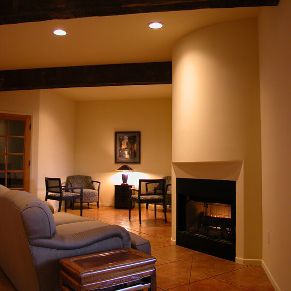 Inside view of the common room, focus on a few couches and the fireplace