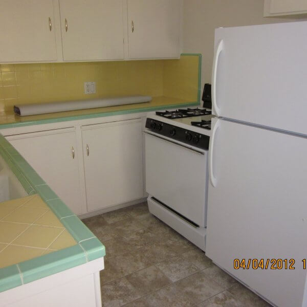 Kitchen with stove and refrigerator